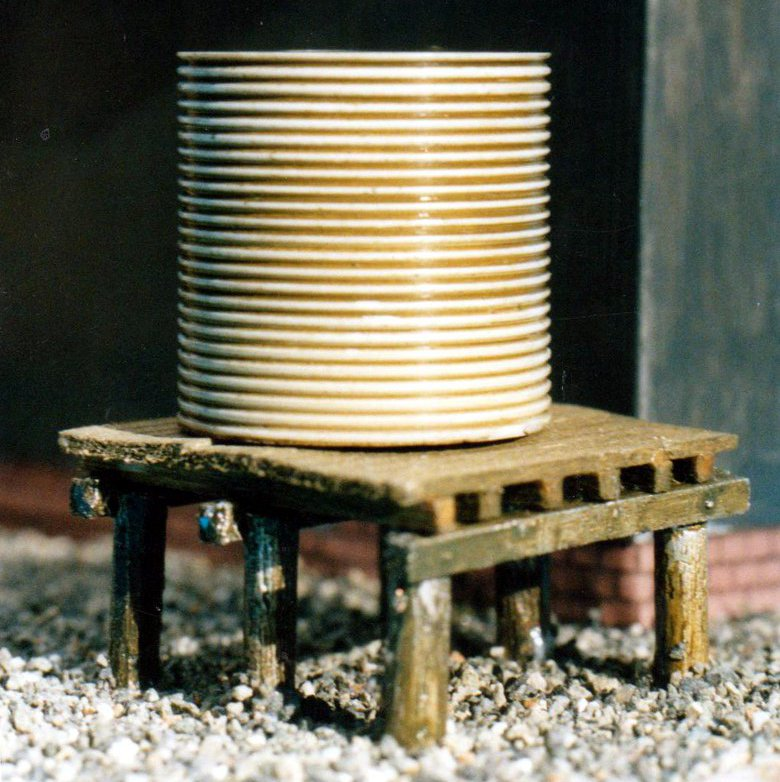 Corrugated iron water tank on base